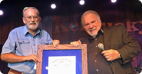 Gene Watson was honoured with the commission of Kentucky Colonel during his show, on Friday 25 October 2019, at Kentucky Opry in Benton, KY.  While on stage in Benton, Kentucky, Bill Cates, a longtime fan of Gene Watson's, presented the honour on behalf of Governor Mathew Bevins.